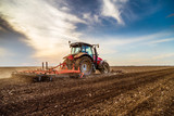 Tractor cultivating field at spring - 201749552