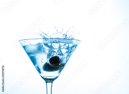 martini in glass with splashes and olives © pavel siamionov