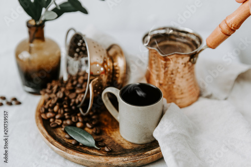 Wall mural Arabic coffee pot with beens. Rural scene