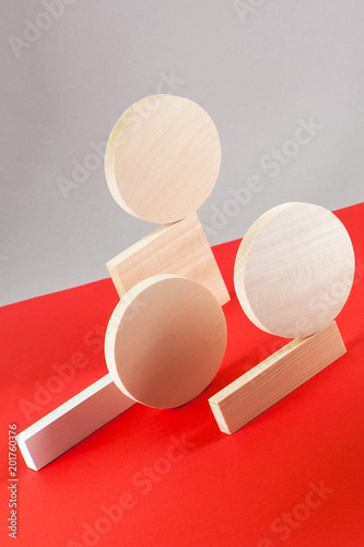 Abstraction from wooden geometric figures on a gray-red background..