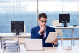 Young handsome businessman employee working in office at desk - 201764163