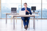 Young handsome businessman employee working in office at desk - 201764375