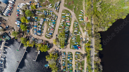 Foto Murales Aerial view of boats on land near the harbor