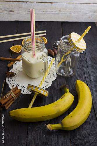 Plexiglas Milkshake milk shake in a jar on a wooden background