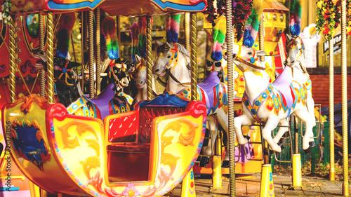 Aluminium Amusementspark horses on a carousel in an amusement park, toned