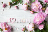 Background to Mother's Day with congratulations and pink peonies - 201784589