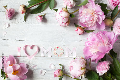 Background to Mother's Day with congratulations and pink peonies