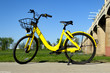 Yellow Rental Bicycle parked on sidewalk