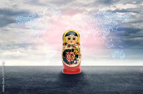 Foto Murales Russian dolls on a background map of the world. The concept of relations between Russia and the world.