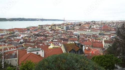 Obraz na płótnie 25 de Abril Bridge over the Tagus river, connecting Almada and Lisbon in Portugal, video in 4k format