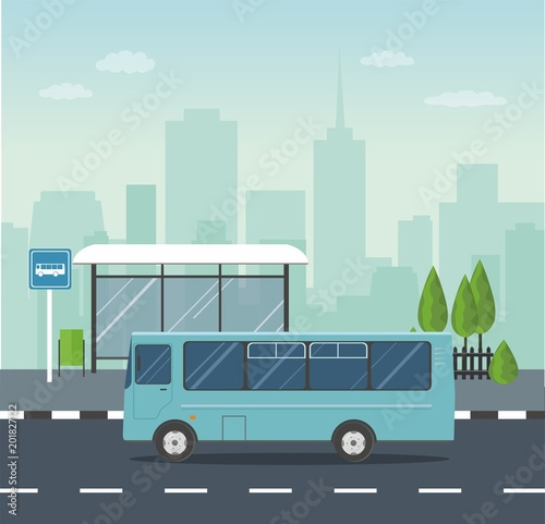 Fototapeta Blue Bus at the bus stop on background of city