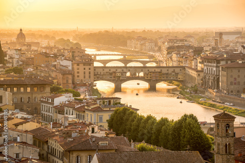 Fotobehang Florence Aerial view of Florence at sunset with the Ponte Vecchio and the Arno river, Tuscany, Italy