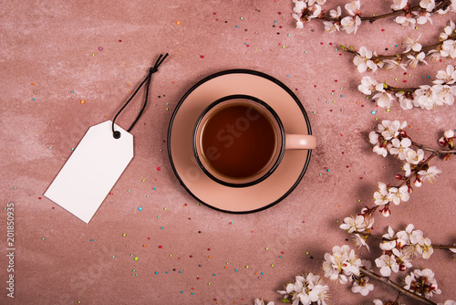 Fototapeta A cup of tea in the spring decoration. View from above. Place for text.
