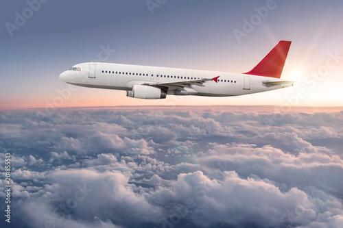 Leinwandbild Motiv Commercial airplane flying above clouds.