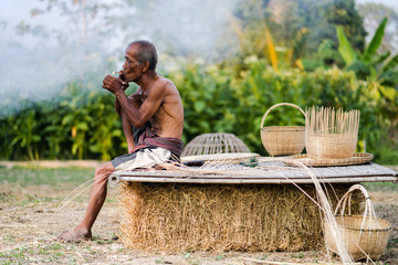 Elderly man lifestyle of the locals with craft bamboo