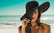 Fashion woman with straw hat at beach