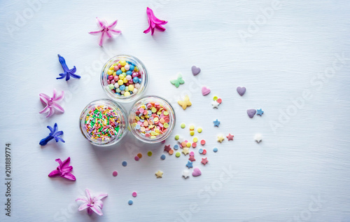 Foto Murales Multicolored sweet items for cake decoration. Top view