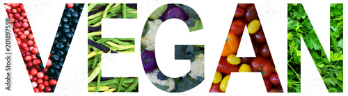 Word vegan laid out to from colourful multi-colored fruits and vegetables. Healthy food concept. Vegetarian product. Organic Raw Produce.