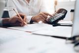 Female accountant or banker use calculator. - 201902154