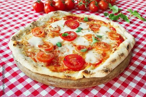 Plexiglas Pizzeria Italian Pizza Margherita with mozzarella, fresh tomatoes and marjoram