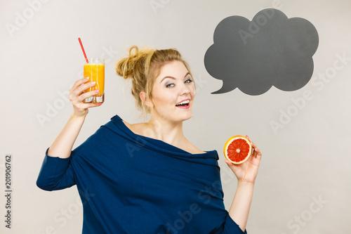 Foto Murales Happy woman holding fresh orange juice