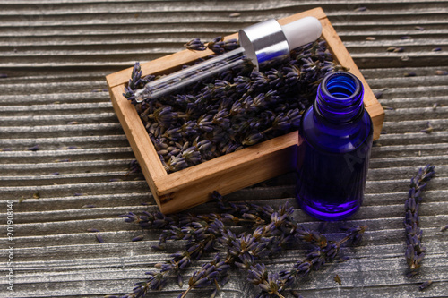 Lavender essential oil on a wooden background - 201908140