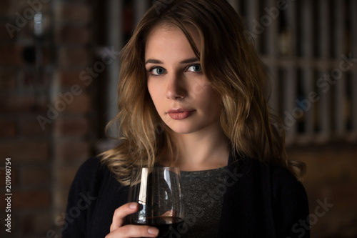 Foto Murales Woman holding wine glass