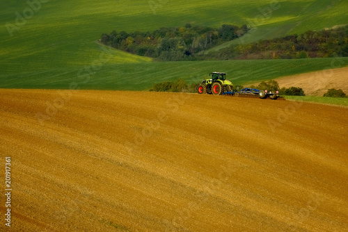 Foto Murales The tractor works on the fields, Moravia, Czech Republic