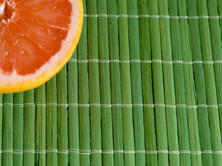 slice of grapefruit on a bamboo background