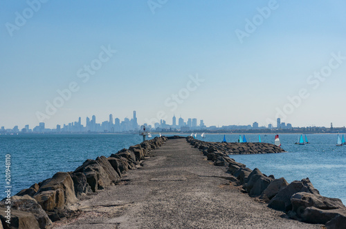 Long pier, jetty with modern cityscape on the background - 201948110