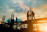 Silhouette of engineer and construction team working at site over blurred background sunset pastel for industry background with Light fair. - 201965916