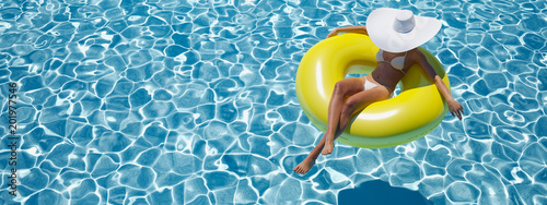 Fototapeta woman swimming on float in a pool. 3d rendering