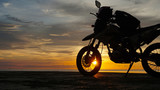 motorcycle on beach and near ocean during sunset. adventure style. - 201977798