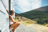 Girl sits on a motor home step - 201981737