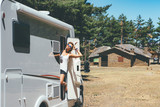 Happy girl relaxes on a motor home - 201982122