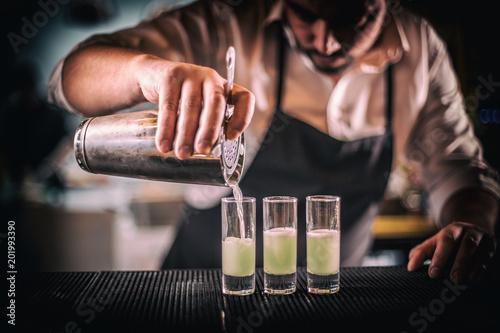 Bartender pouring fresh cocktail