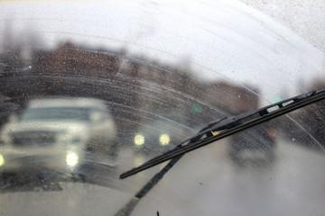 Windshield wipers from inside of car, season rain.