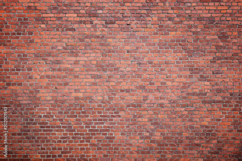 Foto Murales Big full frame background of detailed old red brick wall with vignette. Copy space.