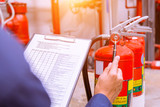 Engineer checking Industrial fire control system,Fire Alarm controller, Fire notifier, Anti fire.System ready In the event of a fire. - 202008769