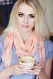 Portrait of beautiful woman in the cafe with a cup of cappuccino - 202010173