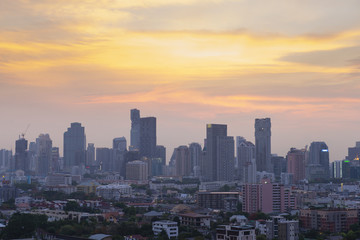 Bangkok modern city skyline at dusk.