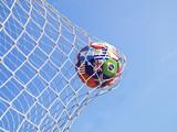 Soccer ball flying to goal - 202023192