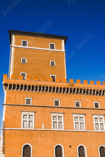 Fridge magnet bottom view of orange building and blue sky in Rome, Italy