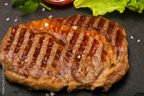 Plexiglas Steakhouse Rib eye steak
