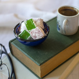 Turkish coffee with Turkish delight  resting on two books - 202036763