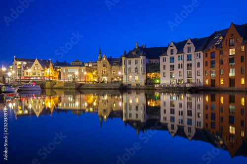 Fotobehang Donkerblauw Architecture of Alesund town at night in Norway