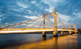 Albert Bridge and beautiful sunset over the Thames, London, England UK