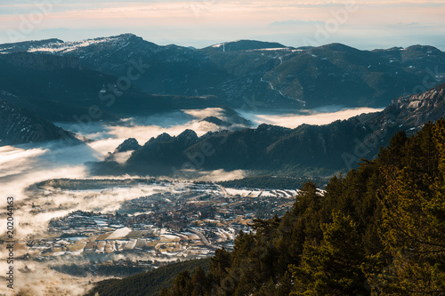 village in the fog covered valley - 202044163