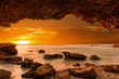 Sunrise at the sea from a cave