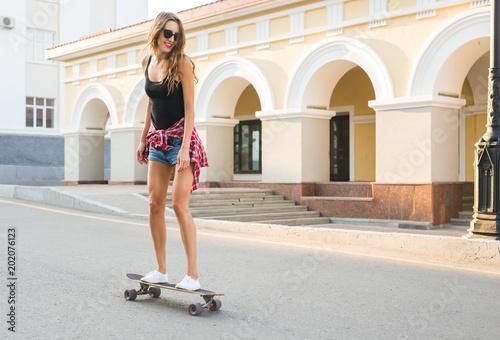 Aluminium Skateboard Beautiful young hipster woman with skateboard outdoors